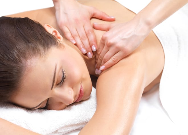 Woman receiving shoulder massage at Holistic Massage & Wellness Clinics