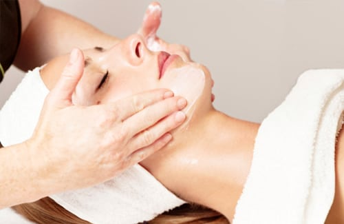woman receiving facial massage in plantation fl
